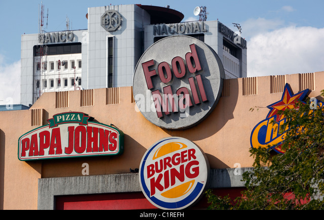 American fast food logos on a building in San Jose, Costa Rica - Stock Image