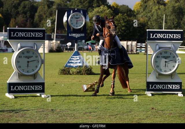 Ireland's Billy Twomey drops the trophy as he and Lizziemary celebrate after winning the Longines King George - Stock Image