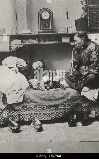Opium Smoking - China, circa 1910 - Stock Image