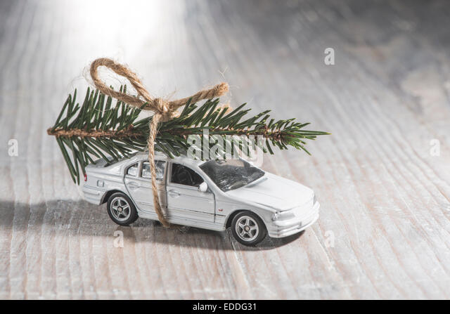 White car toy with Christmas tree on roof - Stock Image