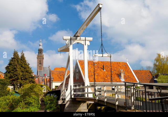 Traditional Footbridge over a Canal, Edam, North Holland, Netherlands - Stock Image