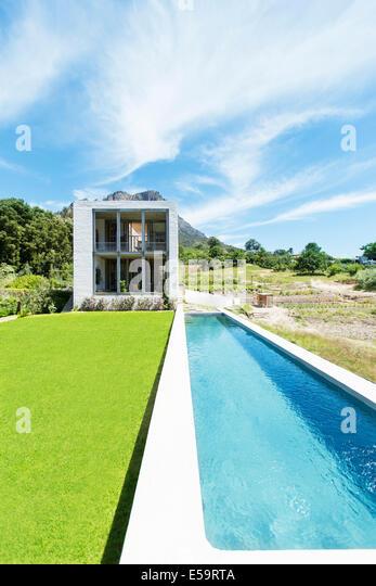Modern swimming pool under blue sky - Stock Image