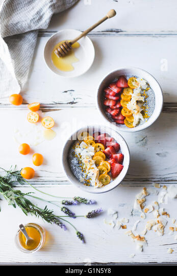 chia pudding breakfast bowls with kumquats, berries & lavender honey. Gluten-free, dairy-free. - Stock Image
