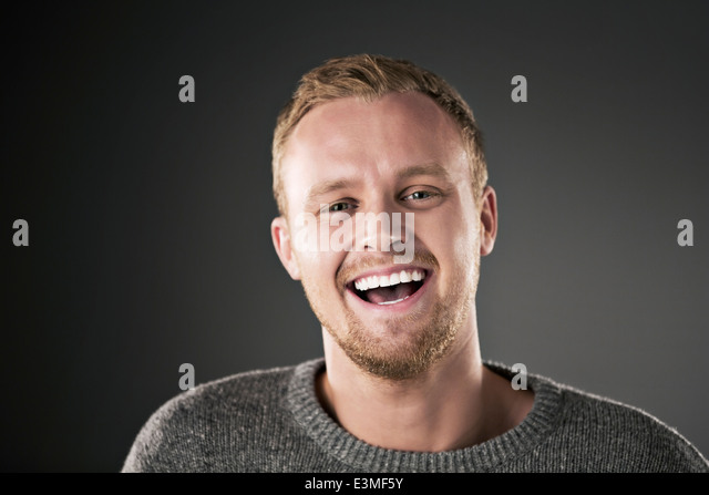 Portrait of laughing man - Stock Image