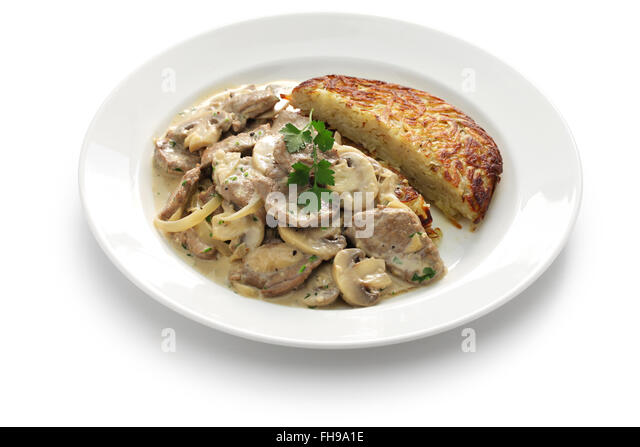 Zurich style veal stew and rosti potato, Swiss cuisine - Stock Image
