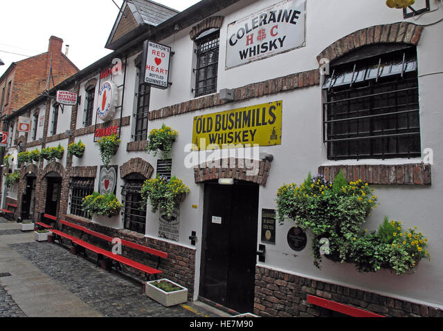 Duke Of York Pub,Belfast, showing Old Bushmills Whiskey ads - Stock Image