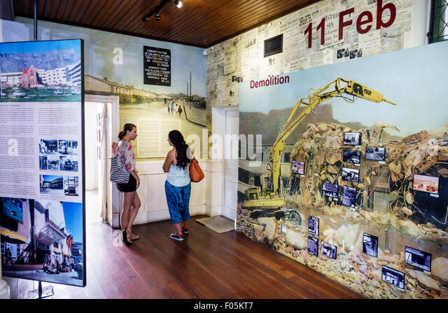 Cape Town South Africa African City Centre center District Six Museum apartheid inside exhibit exhibits woman looking - Stock Image