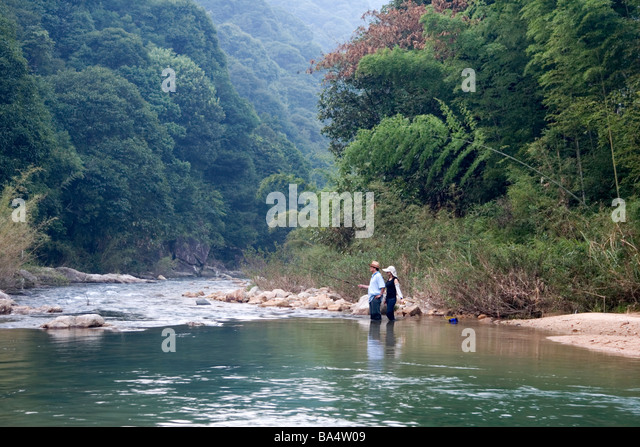 Tourists angling for fish at a river at Nankun Nature Reserve in Guangdong in China. - Stock Image