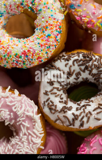 Tasty doughnuts with sprinkles - Stock Image