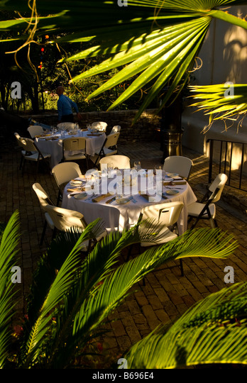 La Villita dining open air restaurant table surrounded green plants historic arts village san Antonio texas tx tourist - Stock Image