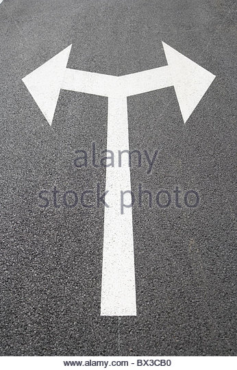 arrow sign on road leading in two directions - Stock Image