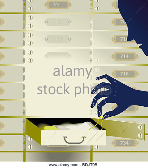 Man removing jewelry from safe deposit box - Stock Image