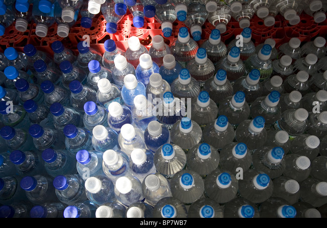 Plastic from bottled water is clogging our landfills and it is questionable if it is better than tap water. - Stock Image