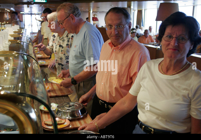 BVI Tortola Holland America Caribbean cruise from New York ms Noordam Lido Restaurant couple food - Stock Image