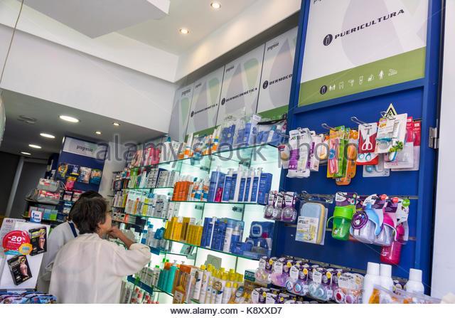 Portugal Lisbon Bairro Alto Farmacia Oliveira Grupo Progresso pharmacy drug store woman shopping childcare products - Stock Image