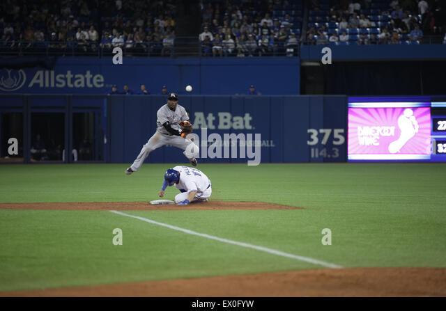 baseball player slide second base - Stock Image