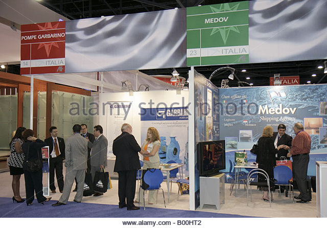 promotion suppliers Italy Italian ports booths networking men women - Stock Image