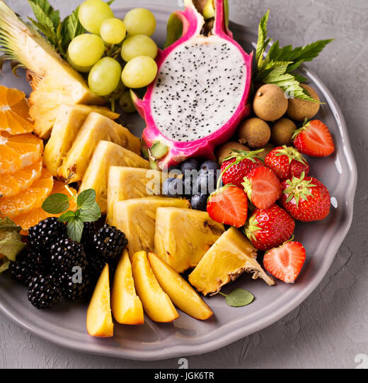 Exotic fruits on a tray - Stock Image