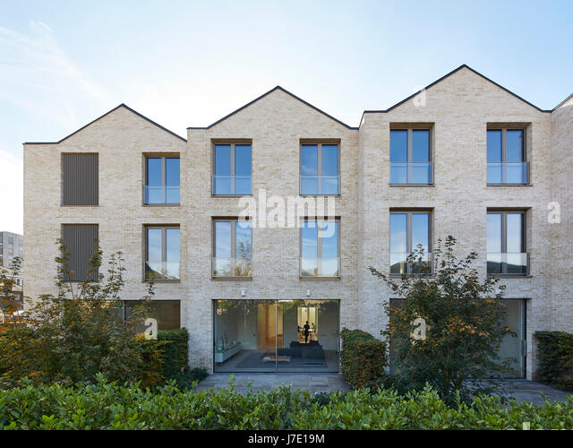 Front elevation through garden with full-height glazing on ground floor. Paradise Gardens, London, United Kingdom. - Stock Image