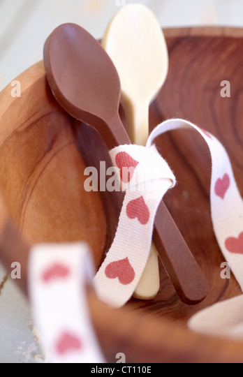 Chocolate spoons tied with ribbon - Stock Image