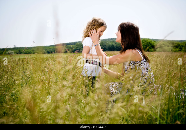 Mother talking to daughter - Stock Image