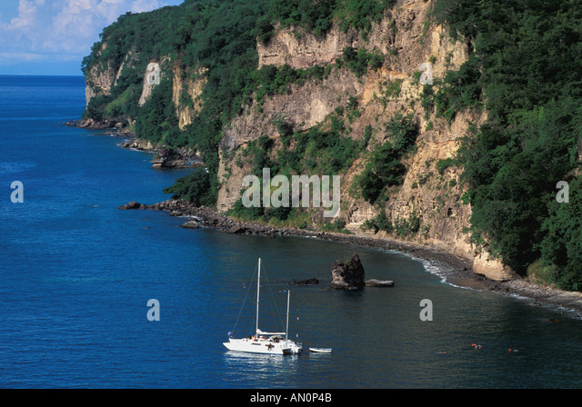 aerial above St Lucia West Indies Caribbean Catamaran and Snorkelers Near Steep Shore - Stock Image