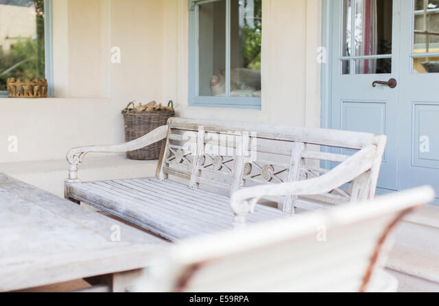Bench and table in modern backyard - Stock Image
