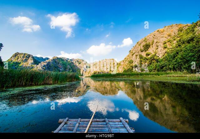 Navigating between the limestone mountains of Ninh Binh in Vietnam - Stock Image