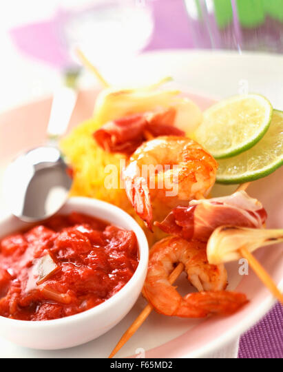 Prawn kebabs with stewed tomato sauce and saffron rice - Stock Image