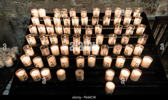 Burning sacrificial candles in a church, Sacré Coeur, Montmartre, Paris, Ile-de-France, France - Stock Image