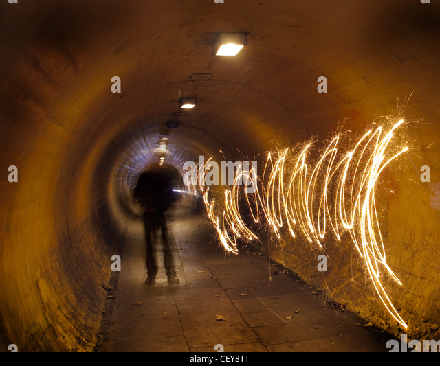 A man in a tunnel at night tunnelvision vision creating a path of light - Stock Image