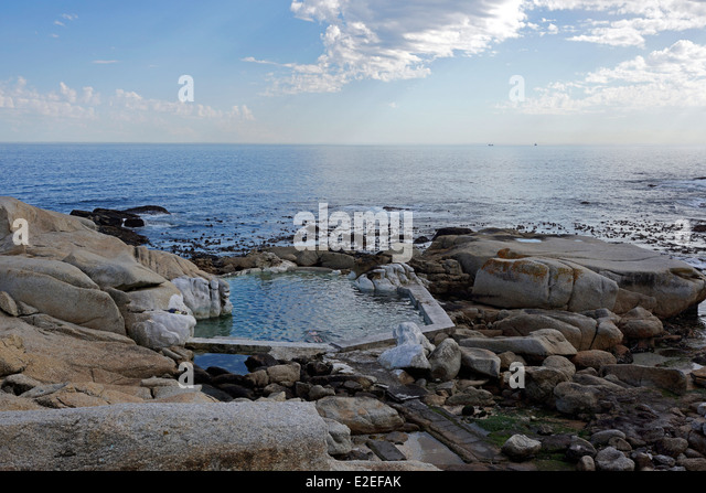 Tidal pool at Saunders Rocks beach , Sea Point, Cape Town. - Stock Image