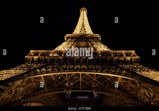 Eiffel Tower low angle view at night - Stock Image