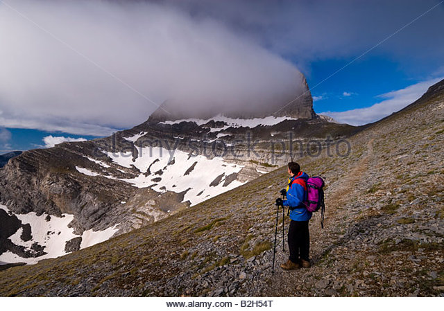Mountaineer on Mt Olympus, with the peak of Stefani in the background, Greece. - Stock Image