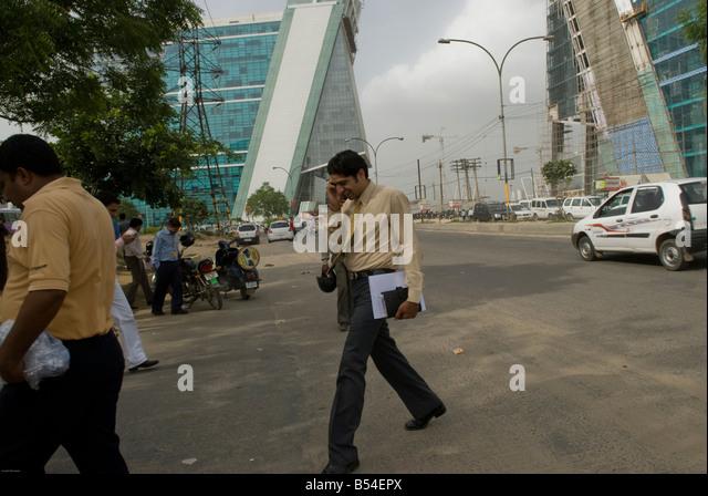 Indian businessman on the phone in Gurgaon, New Delhi CBD, India - Stock-Bilder