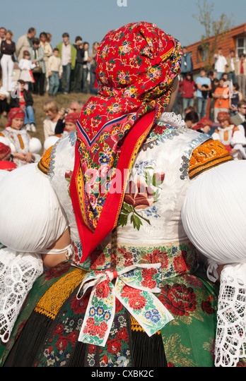 Woman wearing folk dress during autumn Feast Festival, Borsice, Brnensko, Czech Republic, Europe - Stock Image