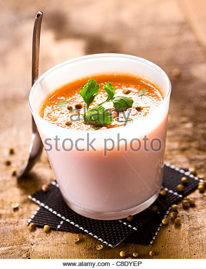 Carrot gaspacho with fresh coriander and coriander seeds - Stock Image