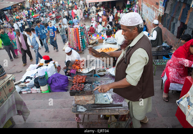 Cooking mutton kebabs in the muslim quarter of Old Delhi - Stock Image