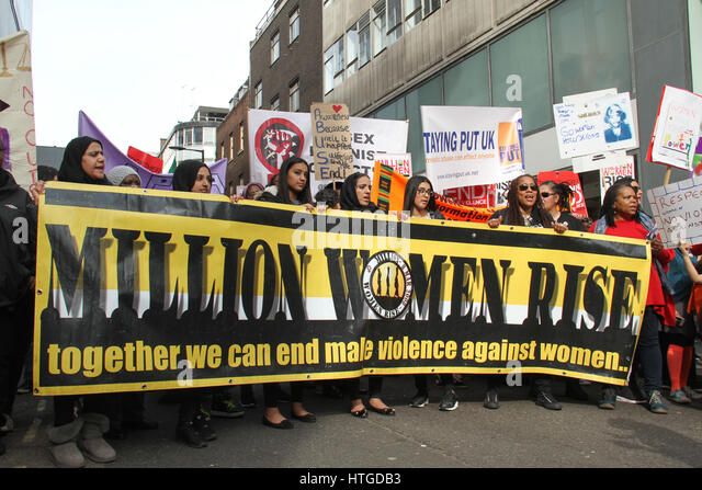 London, UK. March 11,  2017: Protestors hold up a 'Million Women Rise' rise banner on Oxford Steet ahead - Stock Image