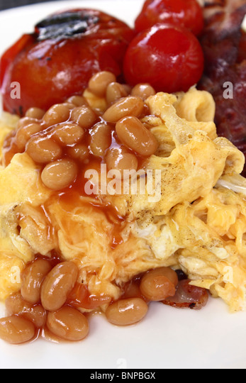 Scrambled eggs baked beans tomatoes - Stock Image