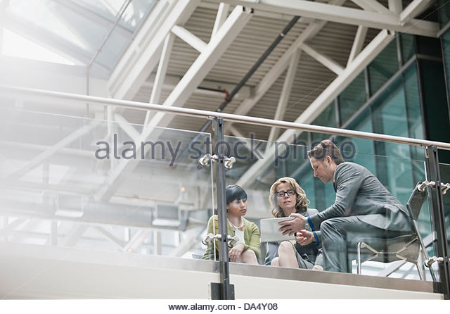 Business people talking together in office building - Stock-Bilder
