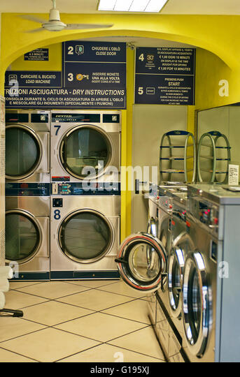 coin operated laundrette stock photos coin operated. Black Bedroom Furniture Sets. Home Design Ideas