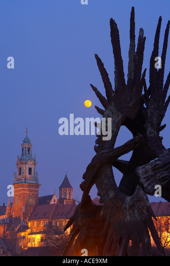 the Wawel, Royal Cathedral at dusk and the War Memorial to WWII Polish soldiers in the foreground Krakow Cracow - Stock Image