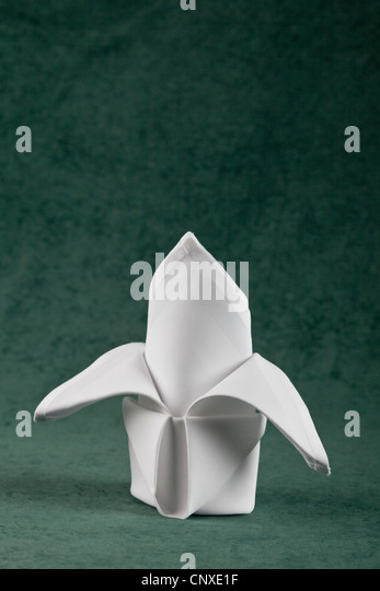 A folded napkin - Stock Image