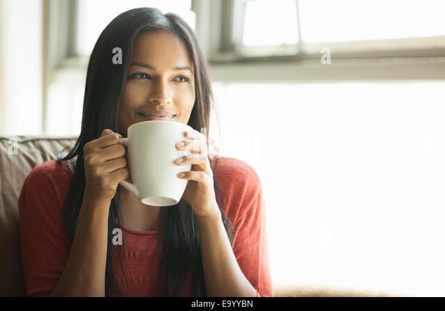 Woman having coffee at home - Stock-Bilder