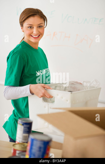 USA, New Jersey, Jersey City, Portrait of young woman as volunteer - Stock Image