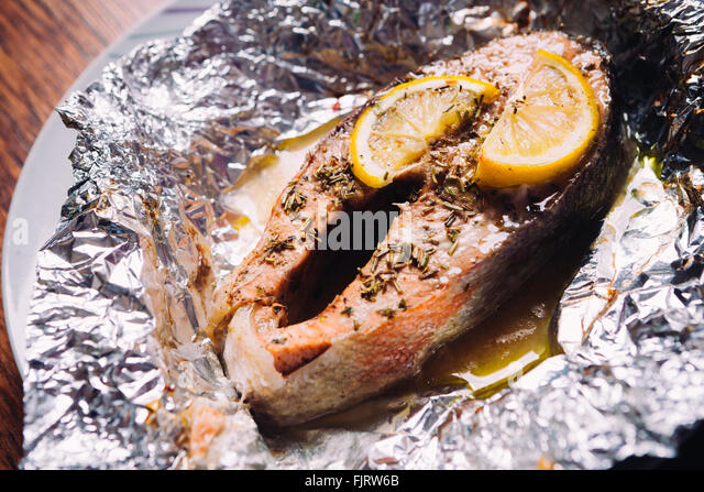 Gour stock photos gour stock images alamy for Baked fish in foil