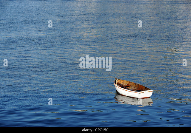 Small rowing boat moored on River Dart in Dartmouth - Stock Image