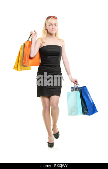 A young female carrying shopping bags - Stock Image