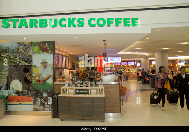 Texas Houston George Bush Intercontinental Airport IAH concourse gate area Starbucks Coffee cafe food court - Stock Image